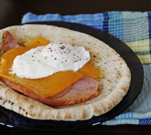 Ham, Cheddar and Poached Egg Pita Breakfast Sandwich