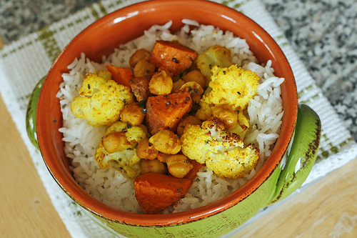 Roasted Cauliflower, Sweet Potatoes and Garbanzo Beans Over Rice