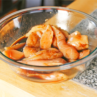 Marinating chicken for Baked Ginger Sesame Chicken and Broccoli