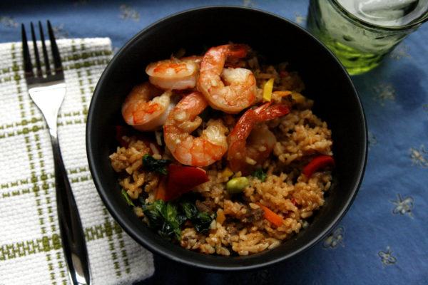 Broiled shrimp with a garlic ginger glaze, served over fried rice.
