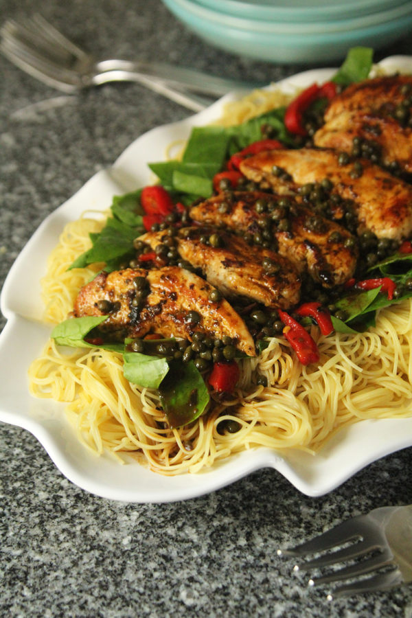 A lemony pasta sauce tops angel hair with chicken, spinach, roasted red peppers and capers.