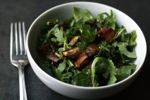 A simple arugula salad, perfect for celebrating the season's freshest flavors.