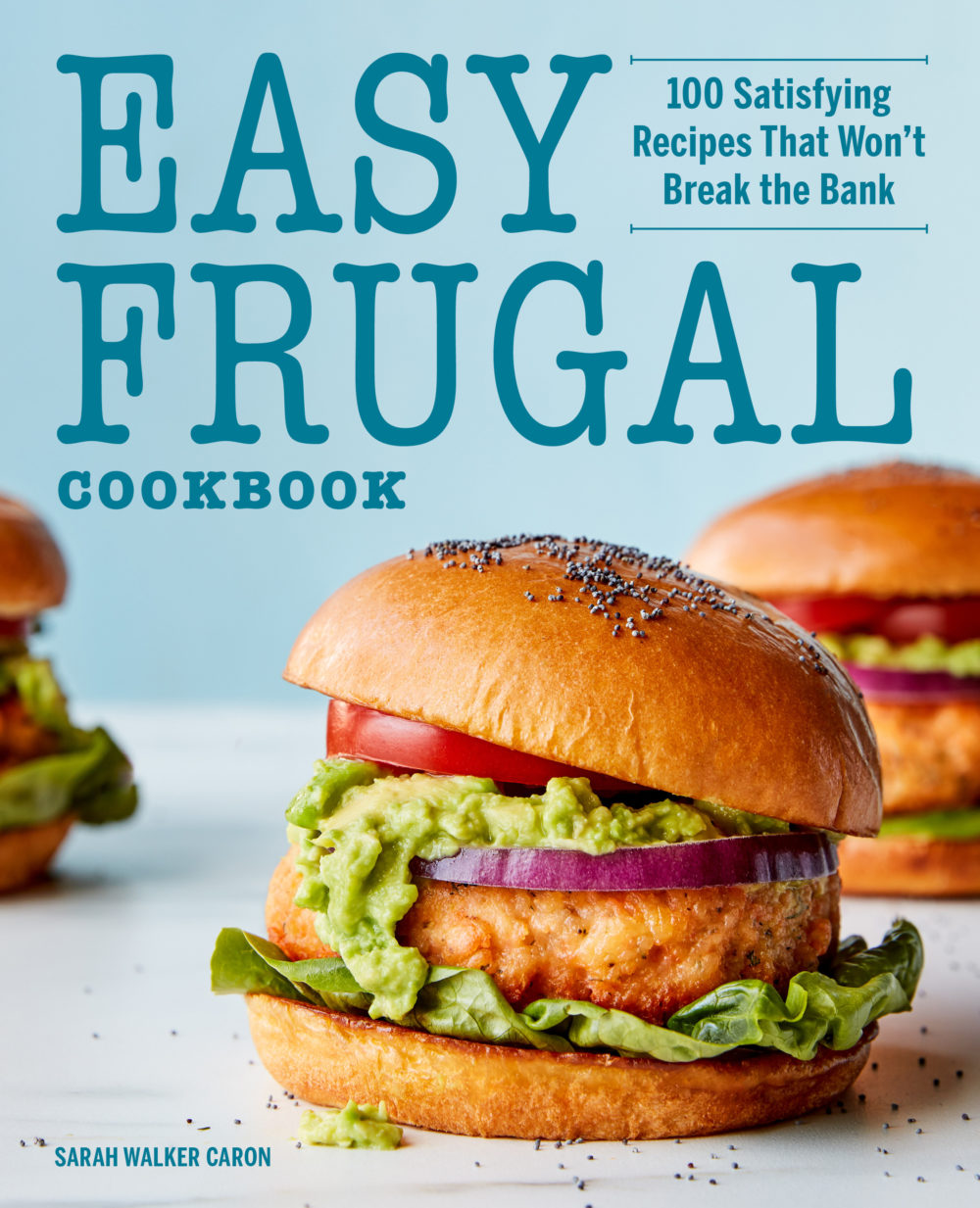 Cover image from Easy Frugal Cookbook, which shows a salmon burger on a poppyseed bun with smashed avocado, red onion, lettuce and tomato.