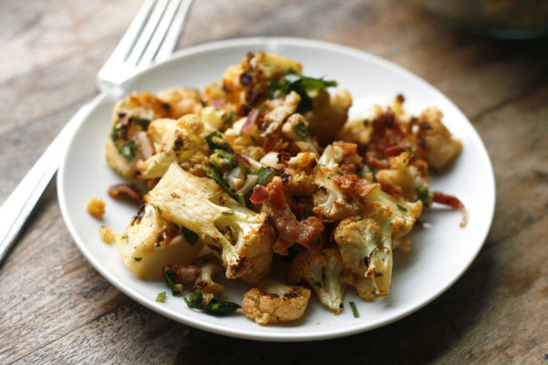 Roasted Cauliflower Salad with Bacon and Lovage is shown on a plate.