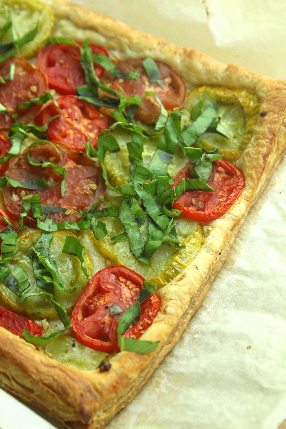 Fresh tomatoes, garlic, olive oil and wisps of basil make this flaky, sweet, bright Tomato Basil Tart brilliant. And it's easy to make!