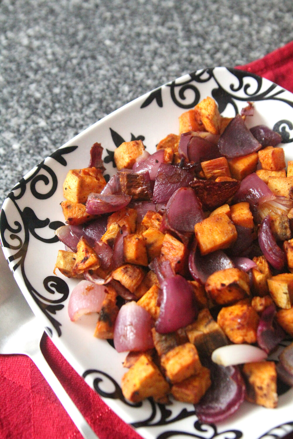 A plate of Roasted Sweet Potatoes and Red Onions with Gochujang Seasoning.