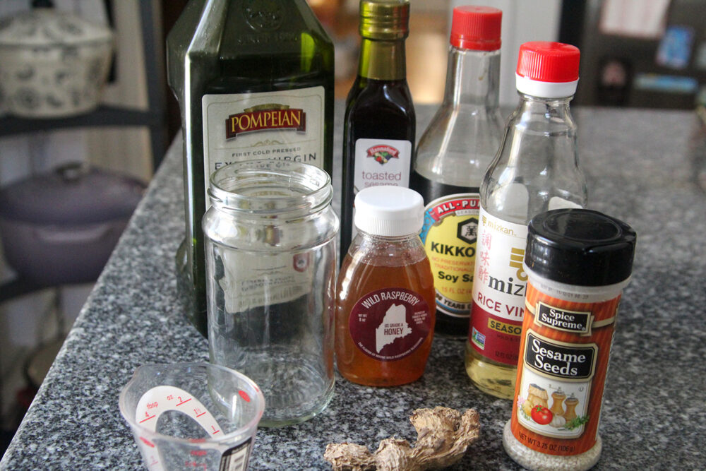 Ingredients for Sesame Ginger Dressing are shown on a granite countertop.